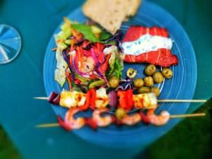 Smoked trout, prawn & chorizo kebabs, halloumi skewers, and Greek salad