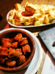 Chorizo in cider and Patatas Bravas